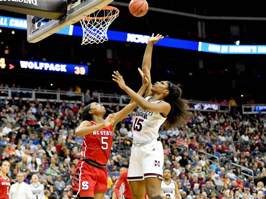 Mar 23, 2018; Kansas City, MO, United States; Mississippi State Lady Bulldogs center Teaira McCowan (15) shoots as North Carolina State Wolfpack forward Chelsea Nelson (5) defends during the second half in the semifinals of the Kansas City regional of the women's basketball 2018 NCAA Tournament at Sprint Center. Mandatory Credit: Denny Medley-USA TODAY Sports