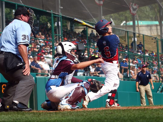 Dean Daddio connects with the ball as Mid-Atlantic
