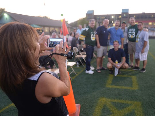Tammy Winekoff takes a group photo of former 1980s