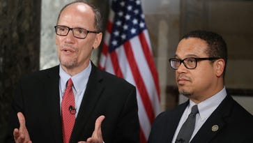 New DNC Chair, Tom Perez (L) and Deputy Chair and Rep. Keith Ellison (D-MN) do a television interview in Statuary Hall at the U.S. Capitol before President Donald Trump delivers a speech to a joint session of Congress on February 28, 2017 in Washington, DC.