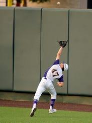 Wylie's Mason Schubert (47) runs down a fly ball during
