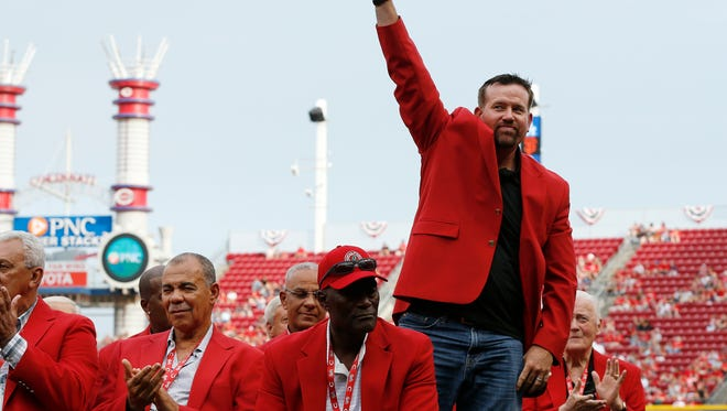Reds Hall of Famer Sean Casey waves to fans as he participates in the Reds Hall of Fame induction ceremony in August.