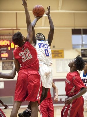Millville's Rynell Lawrence takes a shot as Vineland's Zion Teague, left,  defends during the first quarter of the Cumberland County Tournament boys basketball championship game played at Bridgeton High School on Wednesday.  12.28.16