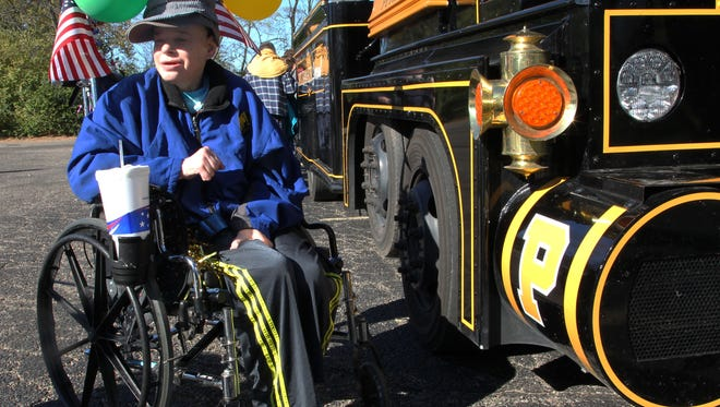 Signature Healthcare resident Bruce Kressel prepares to take a ride on the Boilermaker Special on Sunday, Nov. 13, 2016.