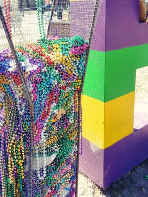 The Y in Downtown Lafayette's sign filled up with beads quickly during the 2016 Mardi Gras season. All beads collected were donated for repair, recycling, and resale.