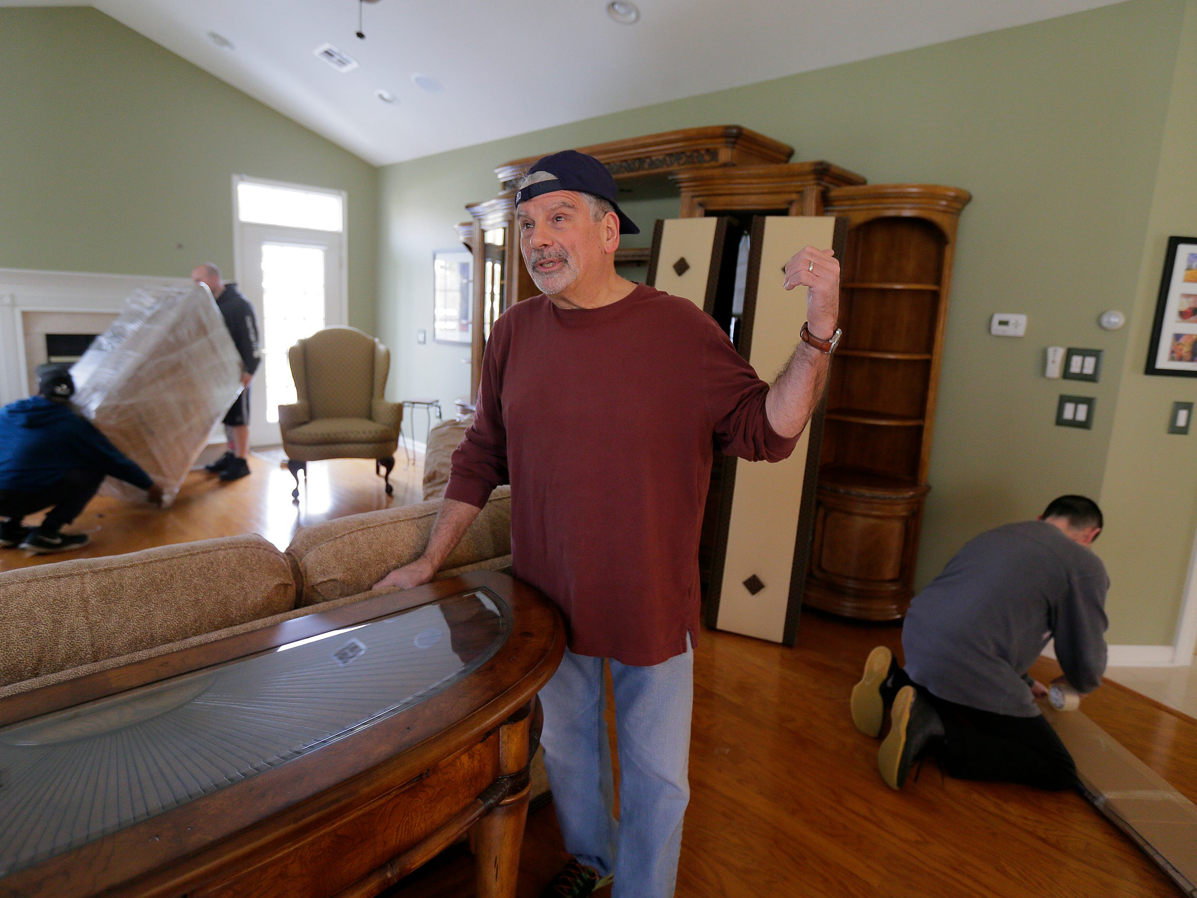 (pictured) Tom Gatti, the founder of the Senior Action Group in Lakewood and one of the most vocal figures in the opposition to township growth, and his wife, Ellen Gatti, move out of their Lakewood home after 12 years in Lakewood, NJ Monday, March 12, 2018.  Workers from Freehold Movers pack the contents of their home and load it onto a truck.