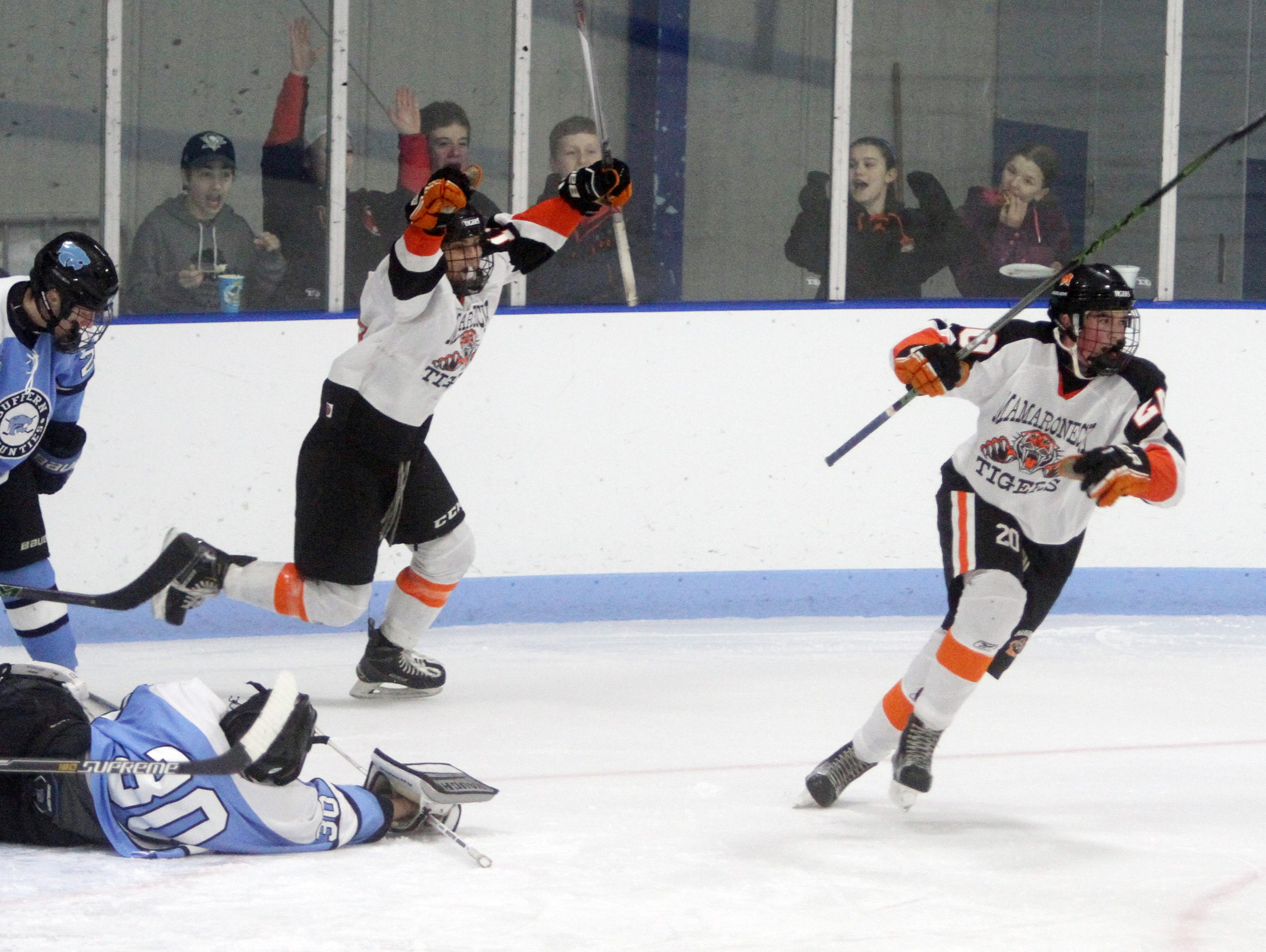 Mamaroneck's Will Payne, right, celebrates after scoring again during a varsity hockey game against Suffern at Hommocks Park Ice Rink in Larchmont Jan. 29, 2016. Mamaroneck defeated Suffern 4-2.