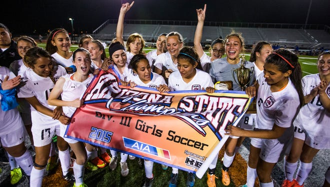 The Walden Grove Girls Soccer team celebrates their victory over Fountain Hills in the Division III championship on Feb. 13, 2015, at Campo Verde High School in Gilbert.