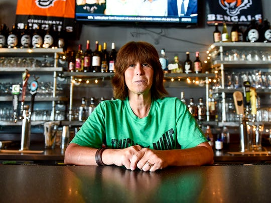 Missy Meddings poses for a portrait at the bar of Twenty-Nine