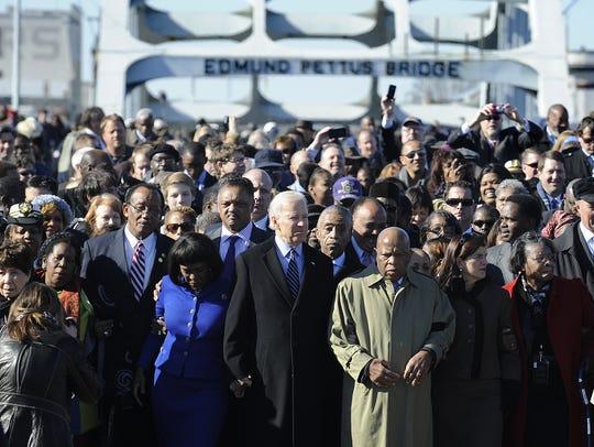 Vice President Joe Biden walks arm in arm with Congresswoman