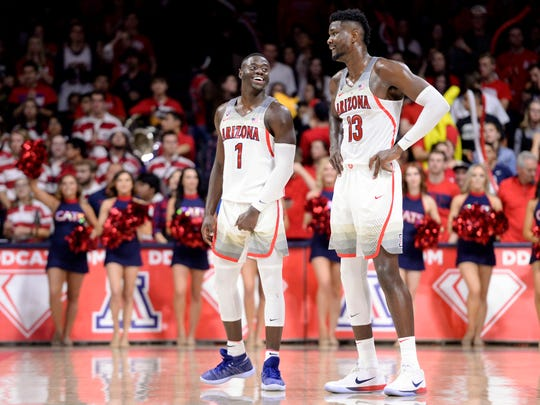 """""""I taught him the spin move, literally, before the game,"""" Arizona Wildcats guard Rawle Alkins (1) said of Deandre Ayton."""