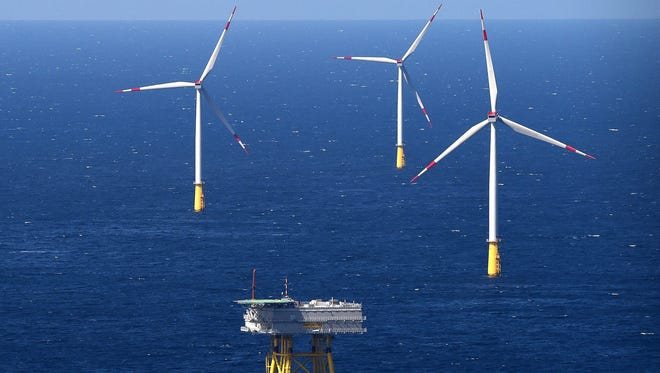 "A substation and wind turbines protrude from the North Sea in the offshore wind farm ""DanTysk"" operated jointly by the Swedish energy company Vattenfall and the city of Munich power utility."