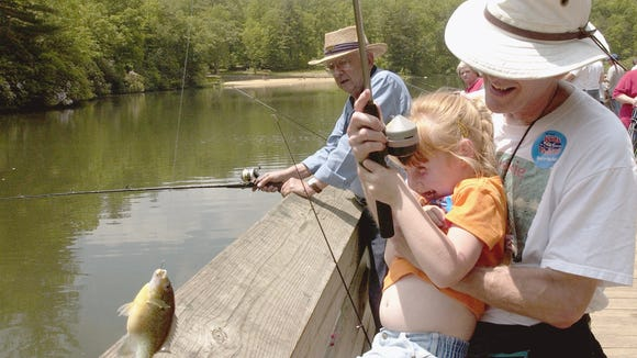Anglers enjoy fishing at Lake Powhatan. The lake in Bent Creek will open with other Delayed Harvest Trout Waters June 3.