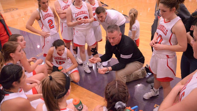 Coldwater girls basketball coach Ken Smoker addresses his team after the first quarter of play against Harper Creek on March 2, 2018.
