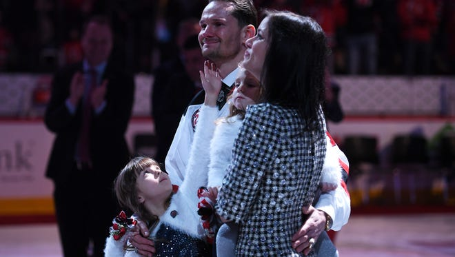 Patrik Elias watches with his family as his jersey is retired during a ceremony before the start of the the game on Saturday, February 24, 2018.