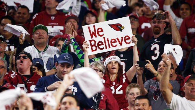 Arizona Cardinals fans cheer during the Seattle Seahawks game on Sunday, Dec. 21, 2014 at University of Phoenix Stadium in Glendale, AZ.
