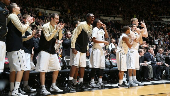 The Purdue bench reacts to a play against Michigan