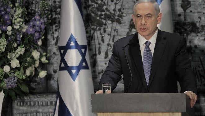 Israeli Prime Minister Benjamin Netanyahu speaks during a ceremony with Israeli President Reuven Rivlin, not seen, in Jerusalem, on March 25, 2015.