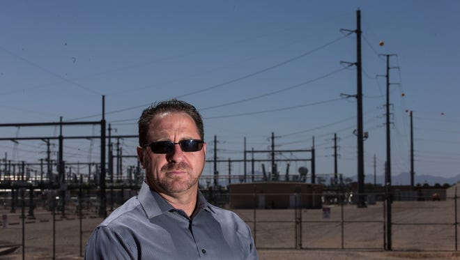 Portrait of Laine Schoneberger, a Chandler resident, who is a organizer of a group called Communities United with his neighbors, fighting plan by SRP to install a 230kV line near his neighborhood near Ocotillo and Arizona Avenue .