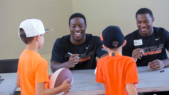 Prattville native Derrick Moncrief signing autographs at Oklahoma State's Fan Day, Saturday, August 8, 2015 at Gallagher-Iba Arena, Stillwater, OK.