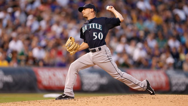 Seattle Mariners relief pitcher Rob Rasmussen (50) works against the Colorado Rockies in the fourth inning of an inter league baseball game Tuesday, Aug. 4, 2015, in Denver.
