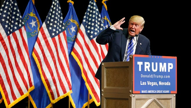 Republican presidential candidate Donald Trump speaks at a rally Thursday, Oct. 8, 2015, in Las Vegas. (AP Photo/John Locher)