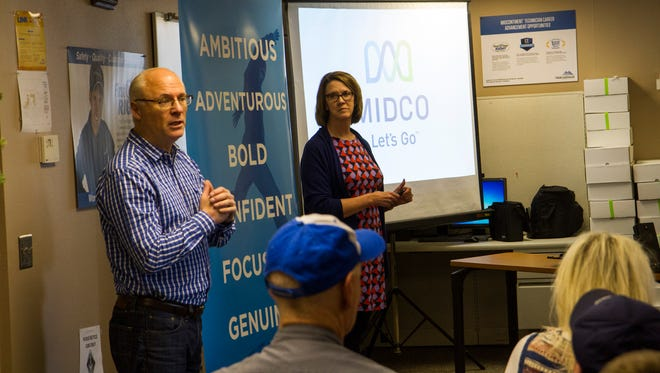 Midco CEO Pat McAdaragh and chief marketing officer Trish McCann speak with employees in Aberdeen about the company's rebranding.