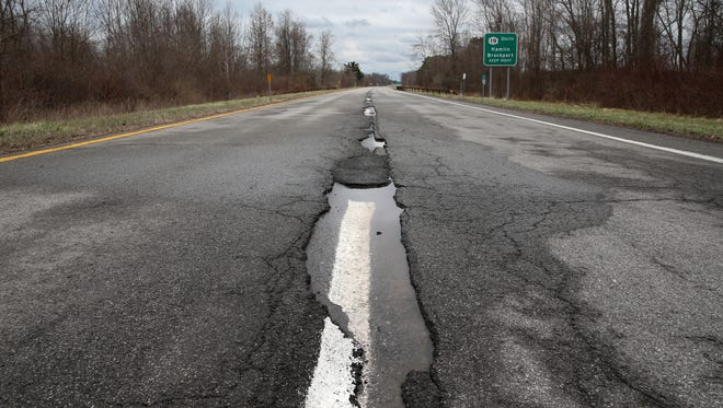 Potholes and deep ruts are commonplace in stretches along the Lake Ontario State Parkway west of Hamlin State Park Thursday, April 7, 2016.