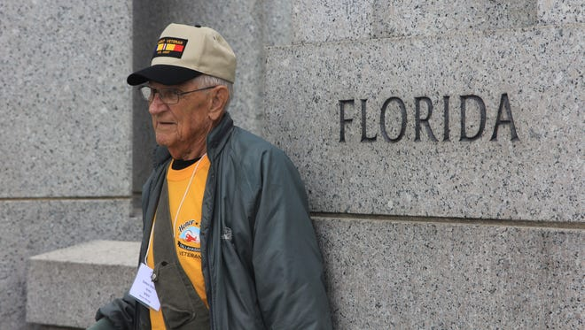 James Oswald, an Army veteran who served in WWII, stands at the Florida pillar of the National World War II Memorial in Washington, D.C.