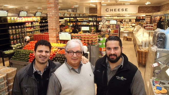 From left, Chris, John and Joe DeCicco stand in the new Millwood DeCicco's and Sons in the former A&P on Route 100 in Millwood Dec. 28, 2016.