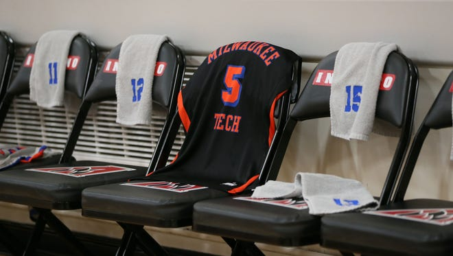Teammates of slain MATC basketball player D'Andre Morehouse leave his jersey on a chair on the sideline during their games.