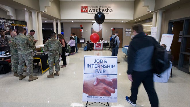 A job fair fills the hallways in the commons at UW-Waukesha. University of Wisconsin System President Ray Cross officially announced a proposal to merge two-year colleges with four-year UW institutions in regional clusters. The two-year UW-Waukesha and UW-Washington County campuses would become branches of UW-Milwaukee.