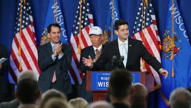 Rep. Paul Ryan, the speaker of the House, speaks at the signing ceremony for Wisconsin's contract with Foxconn Technology Group last November in Racine. Behind him are Gov. Scott Walker (left) and Foxconn Chairman Terry Gou.