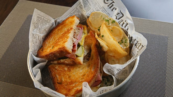 A hearty Cuban sandwich is on the menu in the Avalon Theater, which began preparing the movie menu from scratch in the fall.