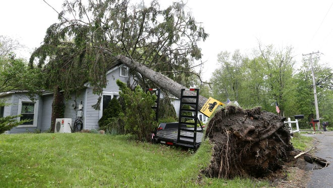 A tree knocked down by Tuesday's storm rests on a home on Osbourne Hill Road in Fishkill on May 16, 2018.