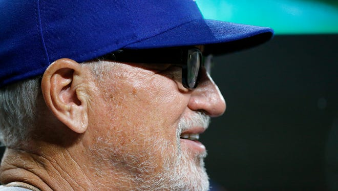 Chicago Cubs manager Joe Maddon (70) watches from the dugout in the eighth inning of the MLB National League game between the Cincinnati Reds and the Chicago Cubs at Great American Ball Park in downtown Cincinnati on Thursday, June 21, 2018. The Reds won the first game of the series, 6-2.