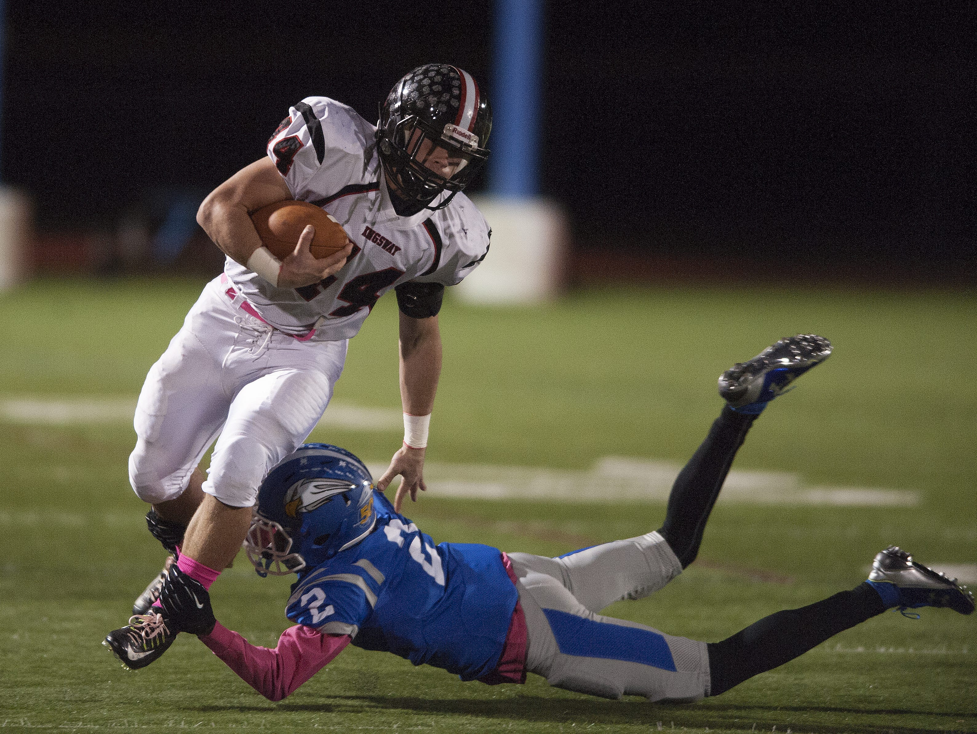 Kingsway's Jay Scerbo , left, runs the ball as he tries to break the tackle of Paul VI's Lonnie Moore in Friday's game.