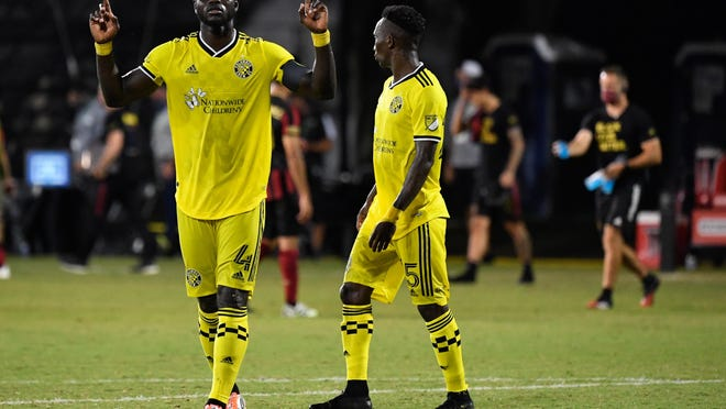 Crew defender Jonathan Mensah, left, and Harrison Afful helped the Crew record three straight shutouts at the MLS is Back tournament, the team's longest such streak in over two years.