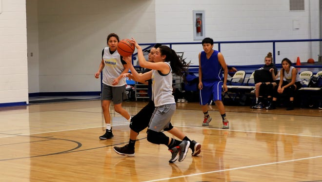 Bloomfield's Lanay Gutierrez comes up with a steal after intercepting the ball in the inner-right passing lane during the Lady Bobcats' practice against the Bloomfield boys' C-Team Monday at Bobcat Gym.