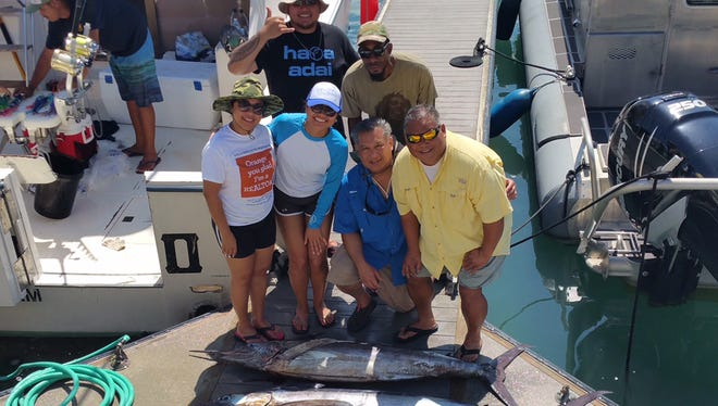 "It's rare for fishermen to catch a marlin in a single outing, but Team Galaide Professional Services Inc. Guam pulled off an amazing feat Aug. 29 about 10 miles out of the Hagåtña boat basin. In one four-hour trip aboard the charter boat Island Girl, members of Team GPSI Guam caught three marlins weighing between 90 and 140 pounds. Charles Terbio said the marlins were the biggest he has ever caught and the most in that span of time. ""A lot of people were pretty impressed,"" he said. Shown are, from left: (front row) Lolita Reyes, Elianna Yanger, Roland Yanger and Al Yanger; (back row) Terbio and Duane Welch."