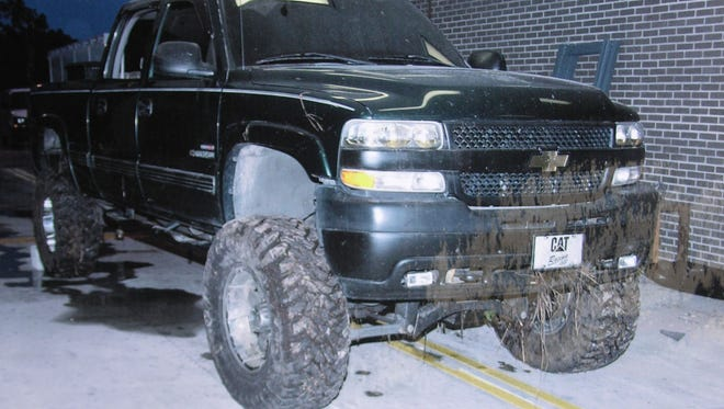 "A photograph of the truck recovered from a pond belonging to a missing volunteer firefighter. At a press conference, family said the reward for information about Brandy Hall, 32 was increased from $1,000 to $10,000. Hall was last seen Aug. 17, 2006. Fishermen a day later found her firefighting gear near  the Palm Bay campus of what was Brevard Community College. Her truck was submerged in the pond, and the cab contained what police call a ""substantial amount"" of her blood. Anglers in western Indian River County found a book bag with Hall's personal items, including clothing."