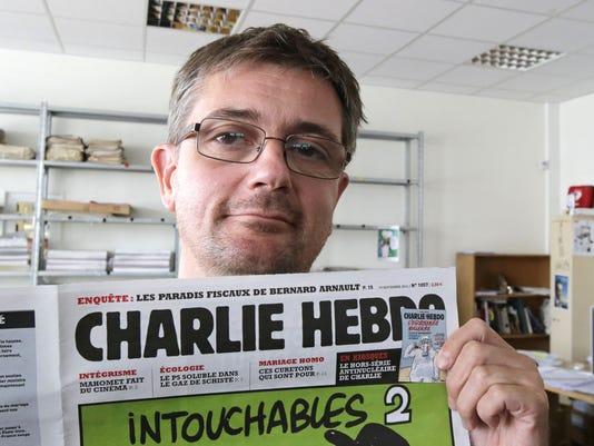 AP FRANCE NEWSPAPER ATTACK I FILE FRA
