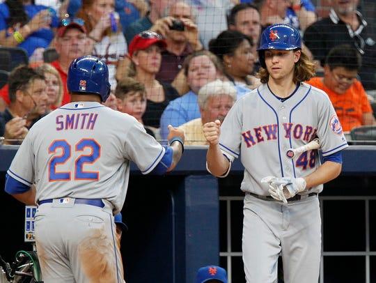 New York Mets starting pitcher Jacob deGrom (48) celebrates