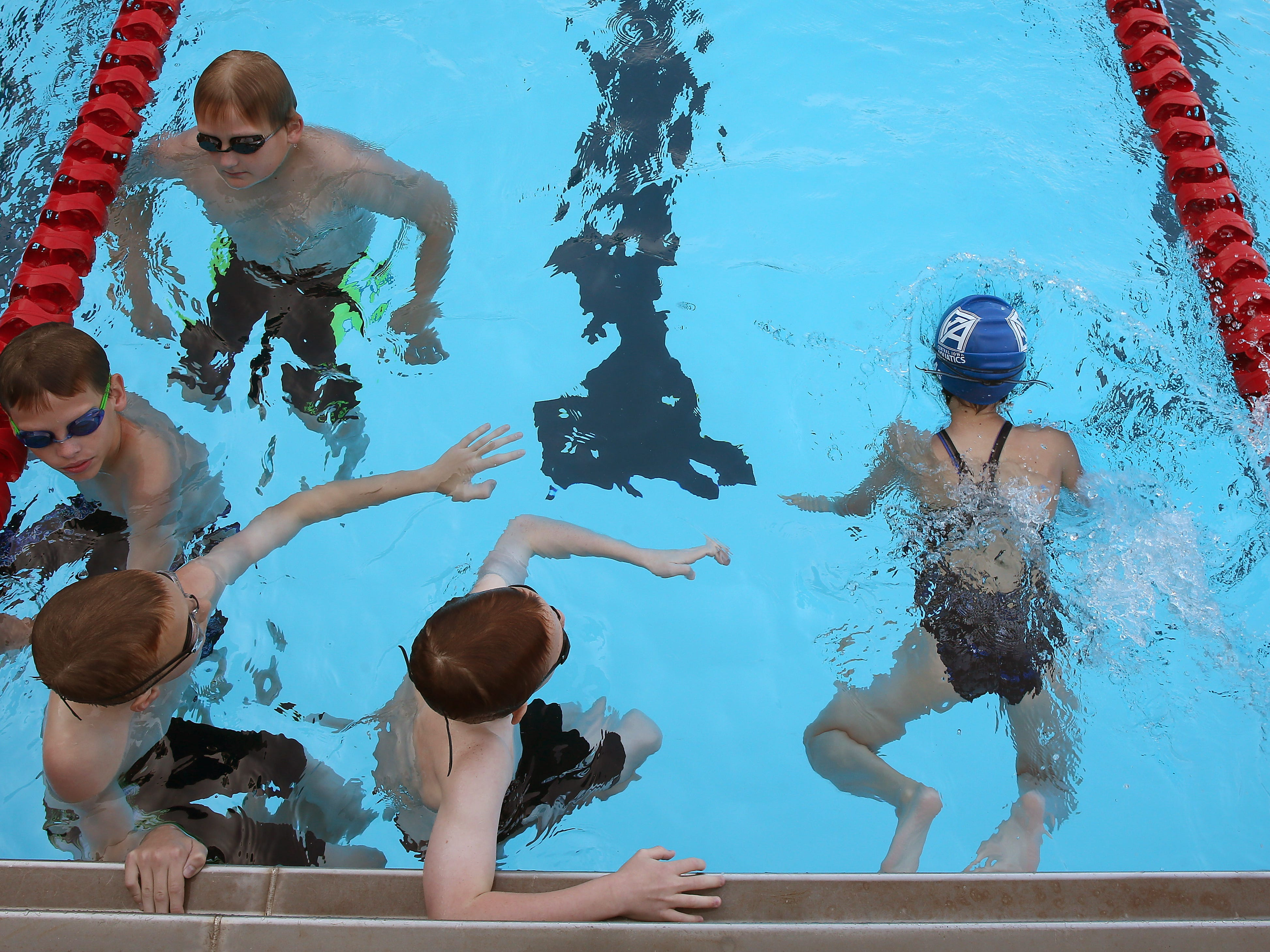 Members of the Central Iowa Aquatics swim club work out Thursday at the Ashworth pool in Des Moines.