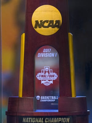 The NCAA 2017 Division 1 national championship trophy is on display during the NCAA Fan Fest at the Phoenix Convention Center on March 31, 2017.