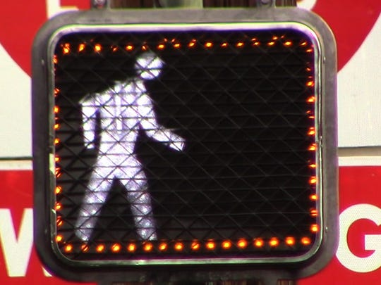 A crossing signal is equipped with a Yellow Pedestrian Border in Redding. Caltrans is pitching the device to the California Traffic Control Devices Committee in Sacramento.