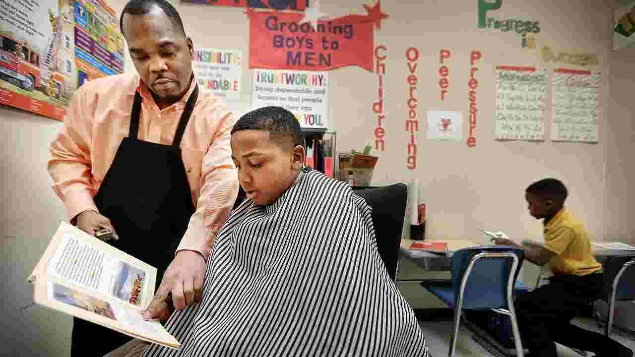Barber Gives Kids Haircuts With Some Class