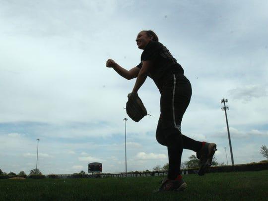 Lakota East's Sydney Larson warms up for her start
