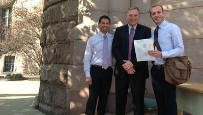 Ethan Hickam, left, with Councilman Chris Seelbach, middle, and Ethan Fletcher outside Cincinnati City Hall after signing up for the city's domestic registry.