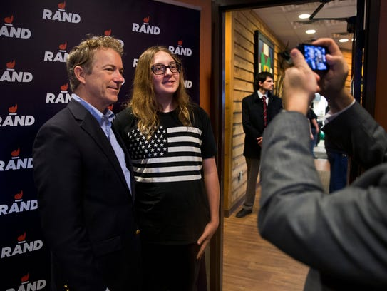 Rand Paul poses with supporter Dalton Reber during